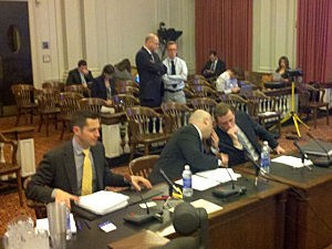 (L-R) Matt Mowers and his lawyers Craig Carpenito and Adam Baker sit before the Bridgegate legislative committee