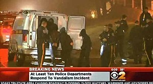 Students involved in a senior prank at Teaneck High School are led to a police van