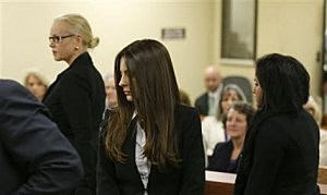 Kerri Kasem, center, the daughter of ailing radio personality Casey Kasem, walks in a Kitsap County Superior Courtroom, along with her stepmother, Jean Kasem, left, and Jean and Casey Kasem's daughter Liberty Kasem, right,