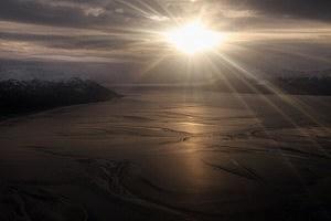 The sun rises over the Turnagain Arm fjord in Alaska