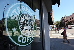 A woman walks past a Starbucks cafe in Manhattan