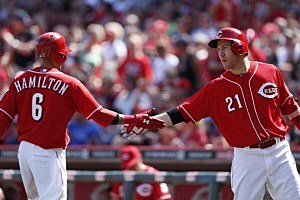 Billy Hamilton #6 of the Cincinnati Reds is congratulated by Todd Frazier #21
