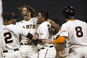 Michael Morse #38 of the San Francisco Giants is congratulated by teammates after hitting a walk off RBI single against the New York Mets during the ninth inning at AT&T Park