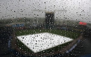 Rain drops bead off of the Kauffman Stadium press box window