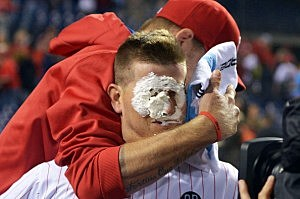 Reid Brignac #17 of the Philadelphia Phillies gets a pie in the face from teammate A.J. Burnett #34 after hitting a walk off three run home run in the ninth inning
