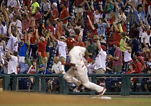 The crowd reacts as shortstop Jimmy Rollins #11 of the Philadelphia ties the all time career Philadelphia Phillies hit record