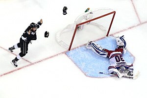Alec Martinez #27 of the Los Angeles Kings celebrates after he scores the game-winning goal in double overtime against goaltender Henrik Lundqvist