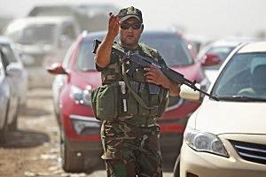Peshmerga military direct traffic at a Kurdish Check point