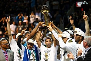 The San Antonio Spurs celebrate with the Larry O'Brien trophy after defeating the Miami Heat to win the 2014 NBA Finals at the AT&T Center