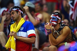 Dejected United States  fans look on after their 2-2 draw during the 2014 FIFA World Cup Brazil Group G match between the United States and Portugal at Arena Amazonia