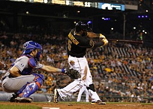 Josh Harrison #5 of the Pittsburgh Pirates hits a walk off double in the 11th inning against the New York Mets