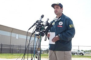 NTSB Senior Air Safety Investigator Luke Schiada speaks at a press conference