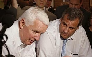 Gov. Chris Christie, right, listens as Pennsylvania Gov. Tom Corbett answers a question from reporters during a campaign stop for Corbett's re-election bid at Primanti's restaurant