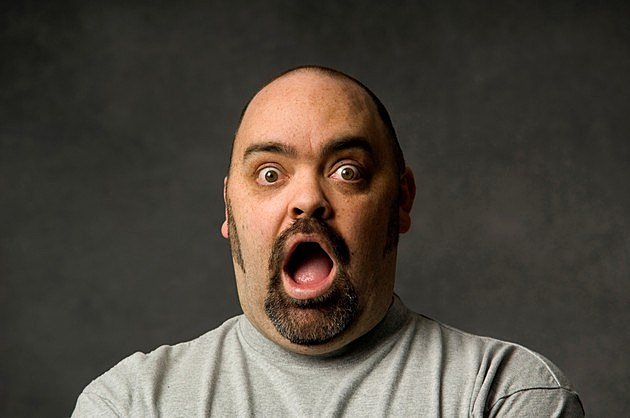 Close-up of surprised man's face, with open mouth.