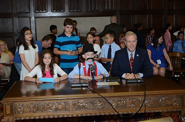 Assemblyman John Wisniewski (D) with two students from the Samsel Upper Elementary School