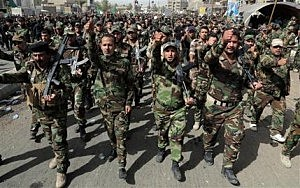 "Volunteers of the newly formed ""Peace Brigades"" participate in a parade in the Shiite stronghold of Sadr City, Baghdad, Iraq"