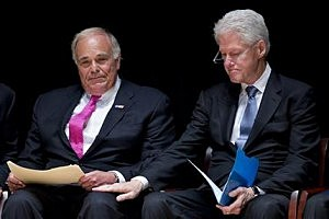 Former President Bill Clinton places a hand on former Pennsylvania Gov. Ed Rendell after Rendell spoke during a public memorial service for Philadelphia Inquirer co-owner Lewis Katz at Temple University
