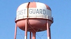 A man can be seen to the right on the water tower at the Coast Guard training facility in Cape May during a standoff
