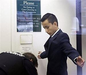Justin Casquejo passes through security at a New York City courthous