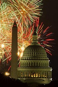 Fireworks illuminate the sky over the U.S. Capitol building and the Washington Monument during Fourth of July celebrations,