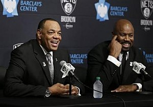 While Brooklyn Nets general manager Billy King, right, listens, Lionel Hollins speaks to the media during a news conference at the Barclays Center in Brooklyn