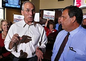 GOP gubernatorial contender Bob Beauprez, left, gestures while he and New Jersey Gov. Chris Christie, right, speak with members of the media during a visit to Sam's in Denver
