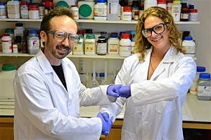 Researchers David Whitworth, left, and Sara Mela, pose for photo in the lab at Prifysgol Aberystwyth University in Aberystwyth, Wales