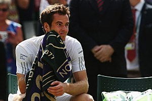 Andy Murray of Great Britain sits dejected during his Gentlemen's Singles quarter-final match against Grigor Dimitrov of Bulgaria