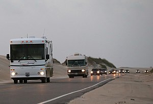 Vehicles drive north on Hwy 12 due to mandatory evacuation for Hatteras Island