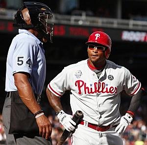 Marlon Byrd #3 of the Philadelphia Phillies reacts to a strike three call