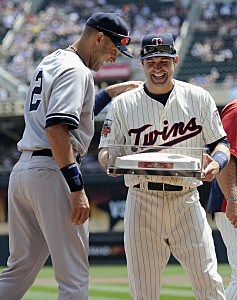 : Brian Dozier #2 of the Minnesota Twins presents Derek Jeter #2 of the New York Yankees with the last second base used at the Metrodome