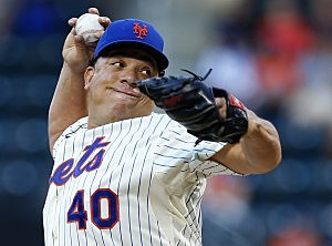 Bartolo Colon #40 of the New York Mets delivers a pitch against the Texas Rangers