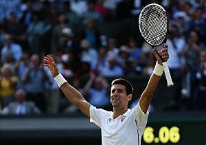 Novak Djokovic of Serbia celebrates championship point and winning the Gentlemen's Singles Final match against Roger Federer