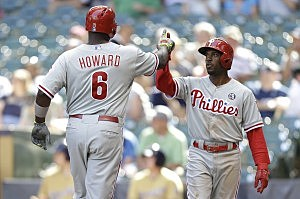 Ryan Howard #6 of the Philadelphia Phillies celebrates with Jimmy Rollins #11 after hitting a two run homer in the top of the ninth inning against the Milwaukee Brewers