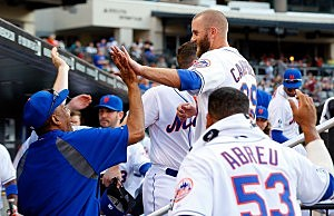 Eric Campbell #29 of the New York Mets is congratulated in the dugout by his teammates after his eighth inning RBI base hit against the Miami Marlins at Citi Field