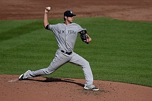 Starting pitcher Shane Greene #61 of the New York Yankees throws a pitch