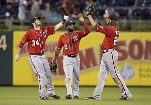 : Outfielders Bryce Harper #34, Denard Span #2, and Jayson Werth #28 of the Washington Nationals celebrate their 5-3 victory over the Philadelphia Phillies