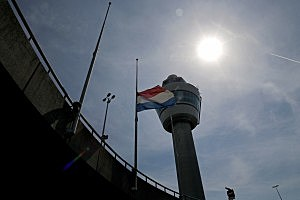 The Dutch flag flys at half mast at Schiphol Airport in memory of Malaysia Flight MH17