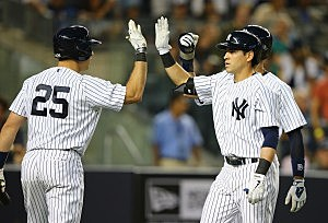 Jacoby Ellsbury #22 of the New York Yankees celebrates his two run home run with Mark Teixeira