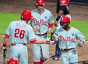 Jimmy Rollins #11 of the Philadelphia Phillies is congratulated by Chase Utley #26 after hitting a seventh inning two run home run against the Atlanta Braves at Turner Field