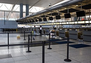 Two people stand a the El Al Airlines ticket desk at Terminal 4 in John F. Kennedy Airport