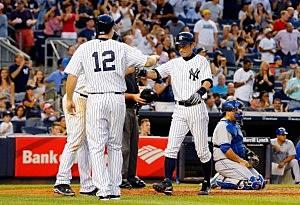 Ichiro Suzuki #31 of the New York Yankees celebrates his third inning three run home run against the Toronto Blue Jays