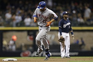 Lucas Duda #21 of the New York Mets runs the bases after hitting a two run homer in the top of the ninth inning against the Milwaukee Brewers