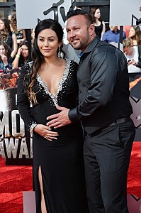 Jenni 'Jwoww' Farley (L) and Roger Mathews attend the 2014 MTV Movie Awards at Nokia Theatre L.A. Live on April 13 in Los Angeles, California.