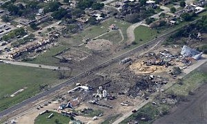 Aerial view of the remains of a fertilizer plant and an apartment complex to the left, destroyed by an explosion in West, Texas in 2013.