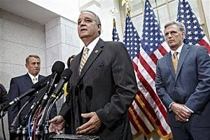 House Veterans Affairs Chairman Jeff Miller, R-Fla., joined by Speaker of the House John Boehner of Ohio, left, and incoming Majority Leader Rep. Kevin McCarthy, R-Calif., right, speaks to reporters on Capitol Hill in Washington D.C.
