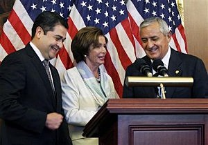 House Democratic Leader Nancy Pelosi, D-Calif., center, is seen with Guatemalan President Otto Molina, right, and Honduran President Juan Hernández
