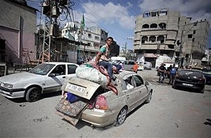 Palestinians salvage what little of their belongings they could from their homes during a 12-hour cease-fire in Gaza City's Shijaiyah neighborhood