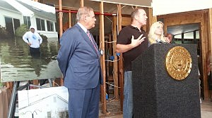 U.S. Sen. Robert Menedez (D-NJ) visits the home of Doug Quinn, a Silverton resident whose home was damaged in Sandy.