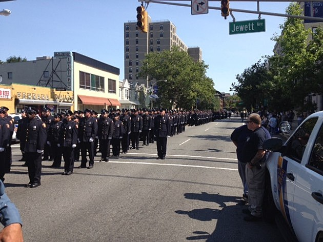Police in the funeral procession for Melvin Santiago